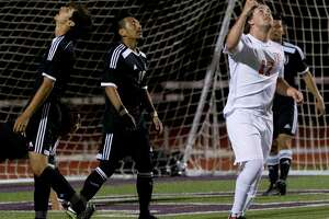 Conroe midfielders Servando Rosales (8) and Alexis Ochoa (10) react to Round Rock midfielder Luke Harbin's game-winning goal during the second period of Region II-6A bi-district high school soccer playoff match at Palestine High School Thursday, March 22, 2017, in Palestine. Round Rock defeated Conroe 2-1.