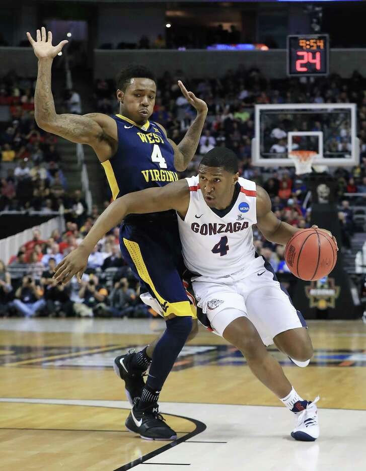 Gonzaga's Jordan Mathews, right, who hit the go-ahead 3-pointer during the final minute of play Thursday night, blows past West Virginia's Daxter Miles Jr.