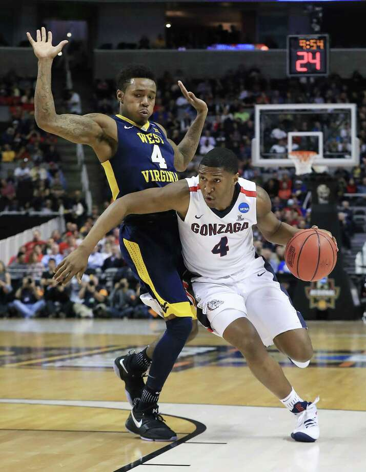 Gonzaga's Jordan Mathews, right, who hit the go-ahead 3-pointer during the final minute of play Thursday night, blows past West Virginia's Daxter Miles Jr.  Photo: Sean M. Haffey, Staff / 2017 Getty Images