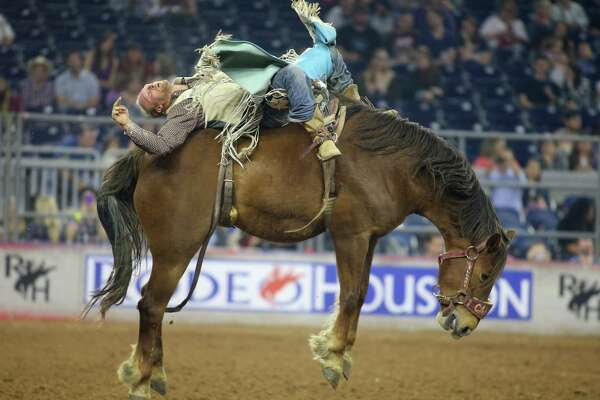 Tyler Nelson held on long enough in the bareback riding semifinal Thursday at RodeoHouston, tying with Mason Clements for first to earn a spot in the finals.