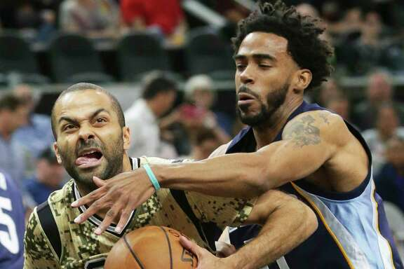 San Antonio's Tony Parker fights his way past Memphis'  Mike Conley to the basket during Thursday's game.