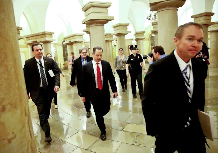 FILE - Office of Management and Budget Mick Mulvaney, right, White House Chief of Staff Reince Priebus, and White House chief strategist Steve Bannon, depart after a Republican caucus meeting on Capitol Hill, Thursday, March 23, 2017, in Washington. (AP Photo/Alex Brandon)  Photo: Alex Brandon / Copyright 2017 The Associated Press. All rights reserved.
