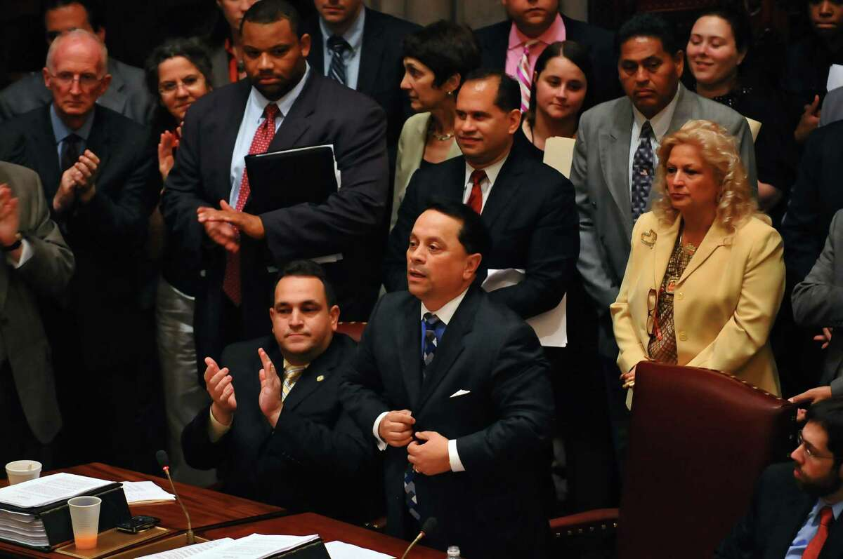 Breakaway Senator Pedro Espada, Jr. speaks after being named Senate Majority Leader during a late night Senate session Thursday afternoon, July 9, 2009. Fellow Democratic Senator Hiram Monserrate sits next to him at left. Espada's wife Connie is at right. ( Philip Kamrass / Times Union archive)