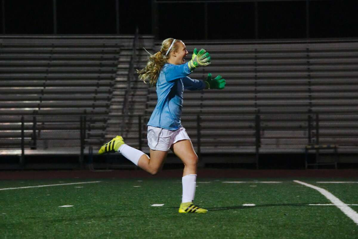 Clear Falls goalkeeper Maddy Anderson celebrates after scoring the winning goal in a penalty kick shootout to secure the victory over Pearland Thursday, Mar. 23 at Friendswood High School.