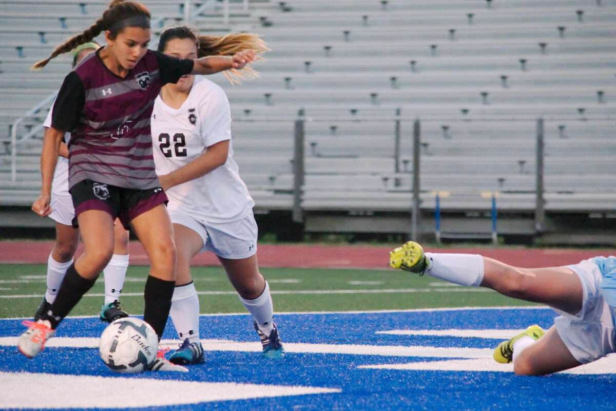 Pearland's Kayla Izaguirre (6) takes a shot to give Pearland the lead over Clear Falls in the first half Thursday, Mar. 23 at Friendswood High School.