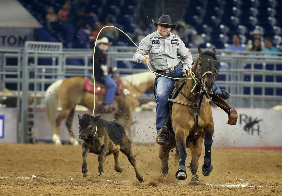 Riley Pruitt participates in the calf roping at the Houston Livestock Show and Rodeo at NRG Stadium on Thursday, March 23, 2017, in Houston. ( J. Patric Schneider / For the Chronicle )
