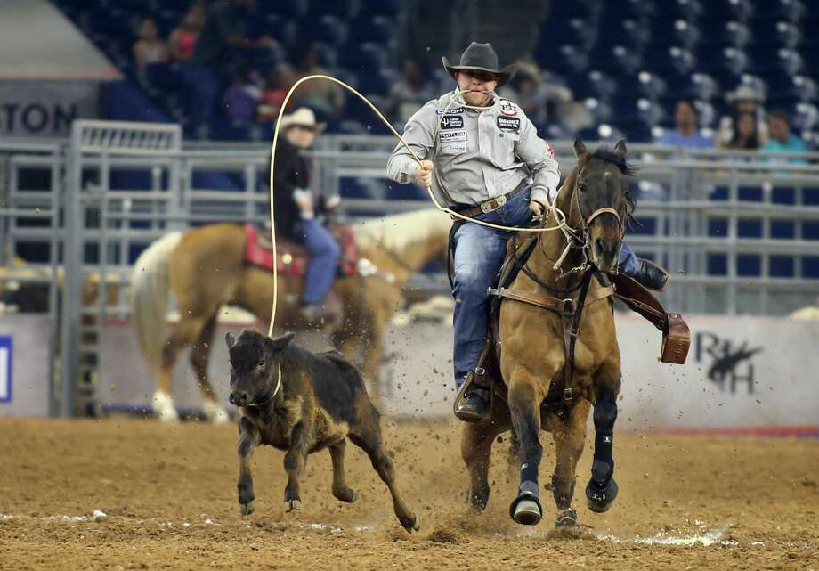 Riley Pruitt participates in the calf roping at the Houston Livestock Show and Rodeo at NRG Stadium on Thursday, March 23, 2017, in Houston. ( J. Patric Schneider / For the Chronicle ) Photo: J. Patric Schneider/For The Chronicle
