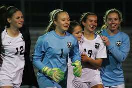 Clear Falls McKayla Heiberger (12), Maddy Anderson (1), Sabrina Saley (7), Nina Zapalac (19), and Kaitylyn Rieke (0)  celebrate after Anderson scores the winning goal in a kickoff to secure the victory over Pearland  Thursday, Mar. 23 at Friendswood High School.