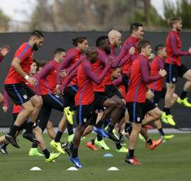 The cellar-dwelling U.S. soccer team warms up during prac tice, preparing for a World Cup qualifier against Honduras.