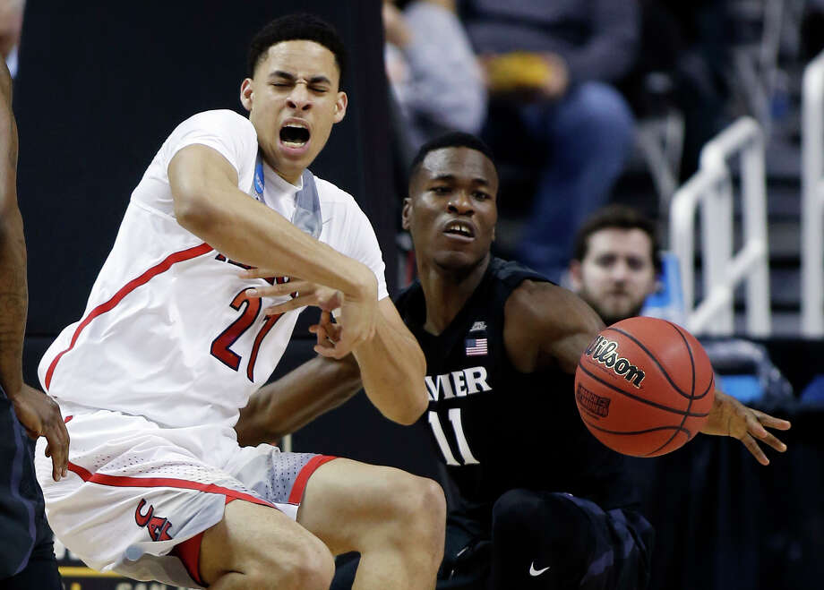 Arizona center Chance Comanche (21) works against Xavier guard Malcolm Bernard (11) during the first half of an NCAA Tournament college basketball regional semifinal game Thursday, March 23, 2017, in San Jose, Calif. Photo: Tony Avelar, AP / FR155217 AP