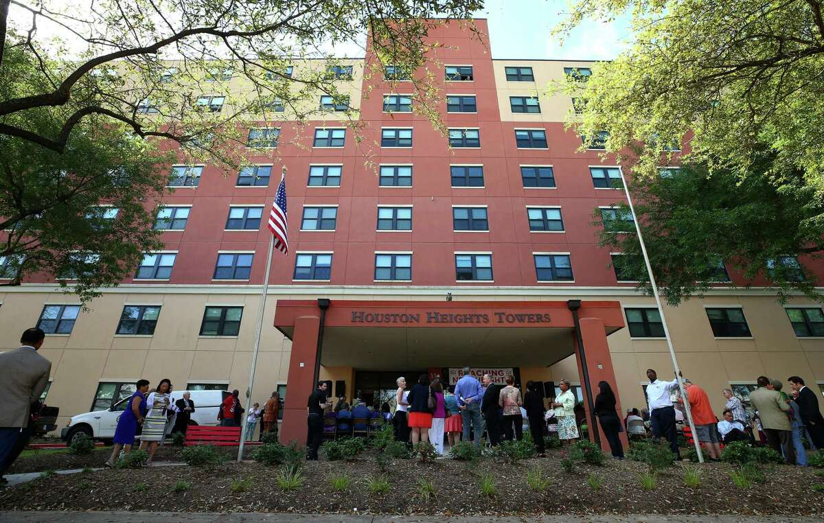People gathered for the rededication ceremony at the front entrance of the Houston Heights Towers Thursday, March 23, 2017, in Houston. The 223-unit mid-rise residence serves low-to-moderate-income senior adults has been renovated with funding from the City of Houston Housing an d Community Development Department and the Community Bank of Texas.