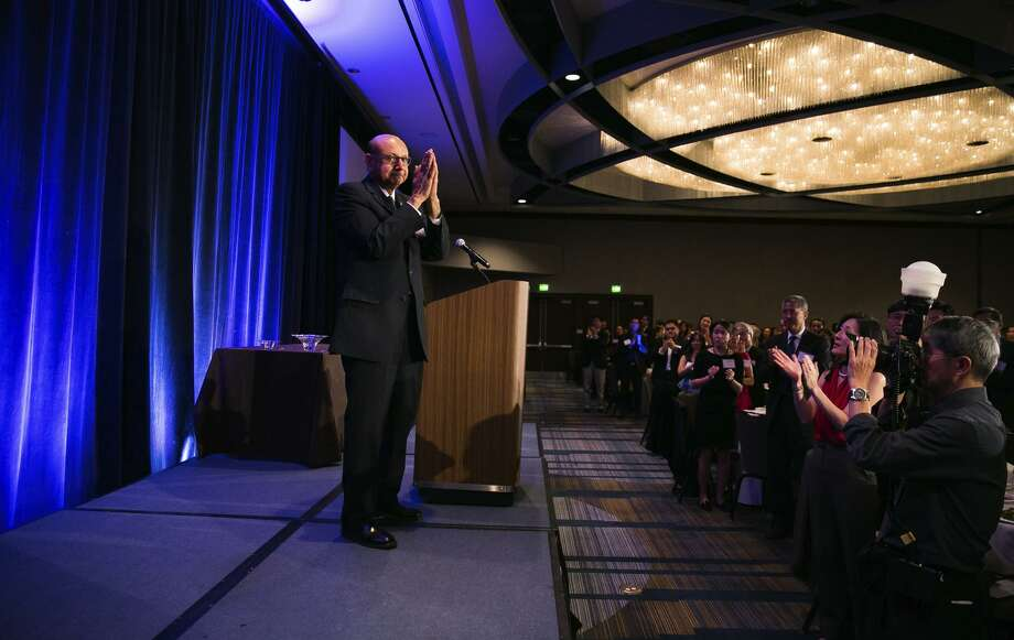 Gold Star father Khizr Khan, who rallied Hillary Clinton backers by pulling out the U.S. Constitution at last year's Democratic National Convention, thanks audience members after addressing the Asian American Bar Association of the Greater Bay Area. Photo: Mason Trinca / Mason Trinca / Special To The Chronicle / ONLINE_YES