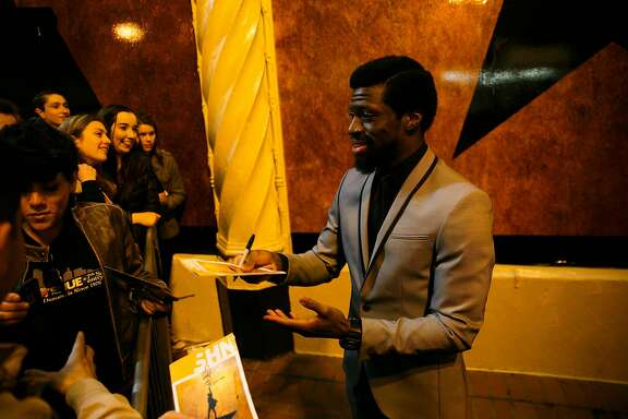 Michael Luwoye, who plays Alexander Hamilton in 'Hamilton', signs autographs outside of Orpheum Theatre in San Francisco, Calif. Thursday, March 23, 2017.