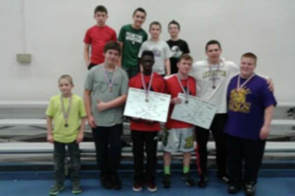 Calvary Baptist Academy placed third at the  Michigan Association of Christian Schools state wrestling tournament.   Pictured are (front row, from left) Xander Ullery, Jonah Wenglikowski, Timothy Neeb, Benjamin Neeb, Christian Court, Nicholas Cuddie;  (back row, from left) Shane Stothard, Tommy Webber, Ian Arnold, Payton Gorman.