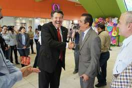 Laredo Mayor Pete Saenz and Nuevo Laredo Mayor Enrique Rivas Cuellar share a laugh Thursday before the start of the tour of the Outlet Shoppes at Laredo.