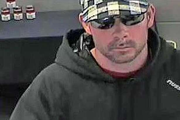 Police are looking for this man that robbed a Webster Bank at 314 Merwin Ave. on Thursday, March 23, 2017. The suspect - described as a white male, standing 6-feet tall with a tattoo on the left side of his neck - entered the bank around 3:15 Thursday afternoon. Police said he handed the teller a note claiming he had a bomb before fleeing in to a waiting green or gray pickup truck that was driven by another person. The Connecticut Bankers Reward Association is offering a $500 reward for information leading to the arrest of the suspect.