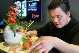 Chef-partner Andy Dong prepares on order of Sushi Sashimi for two at Unagi Sushi Thursday March 16, 2017 in Troy, NY.  (John Carl D'Annibale / Times Union)