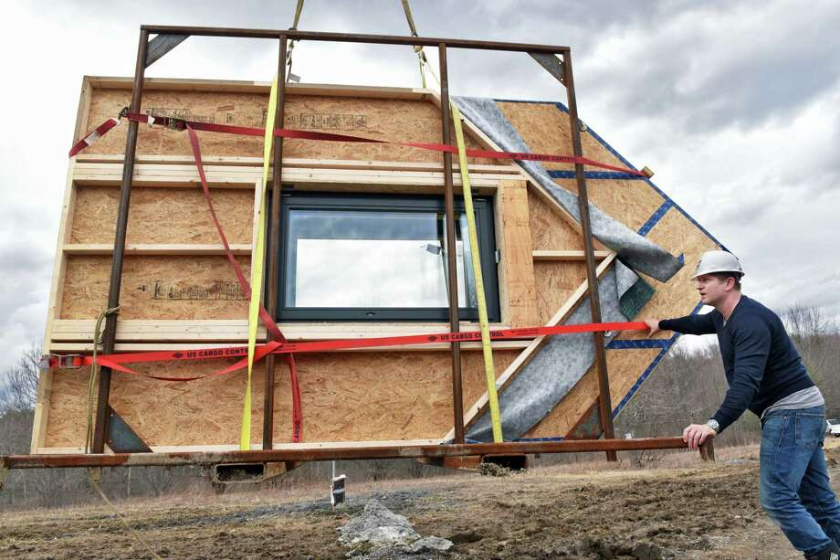 Founder and Technical Director of Ecocor, Chris Corson guides prefabricated gables into position as they construct a house featuring a passive solar design Wednesday March 1, 2017 in Altamont, NY.  (John Carl D'Annibale / Times Union) Photo: John Carl D'Annibale / 20039826A