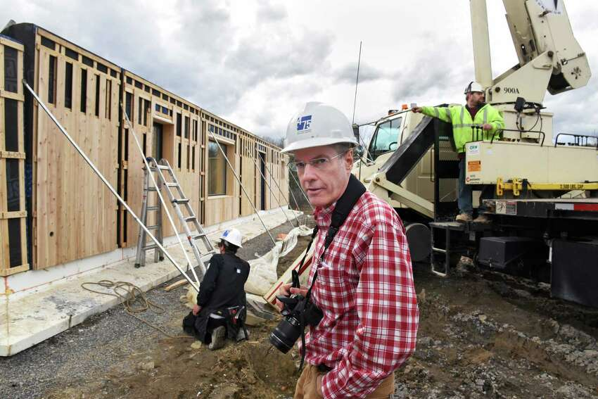 Architect Richard Pedranti uses his camera to document the construction a house featuring a passive solar design Wednesday March 1, 2017 in Altamont, NY. A Passive House is the most stringent low energy building standard in the world, and uses 80% less energy for heating and cooling than conventional homes. (John Carl D'Annibale / Times Union)