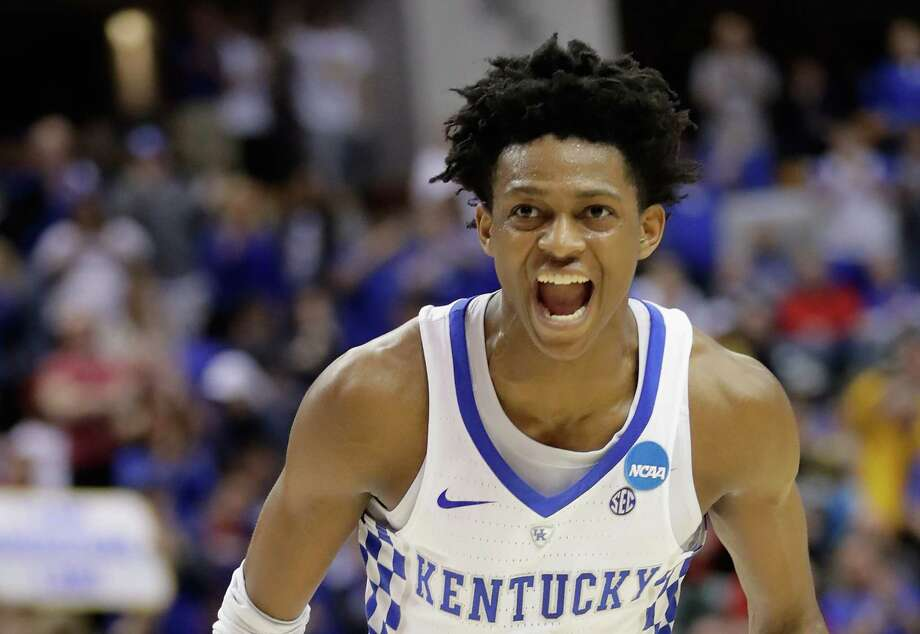 INDIANAPOLIS, IN - MARCH 19:  De'Aaron Fox #0 of the Kentucky Wildcats celebrates his dunk against the Wichita State Shockers in the second half during the second round of the 2017 NCAA Men's Basketball Tournament at the Bankers Life Fieldhouse on March 19, 2017 in Indianapolis, Indiana. The Kentucky Wildcats won 65-62. Photo: Andy Lyons, Getty Images / 2017 Getty Images