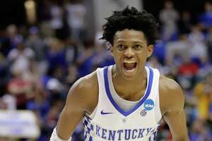 INDIANAPOLIS, IN - MARCH 19:  De'Aaron Fox #0 of the Kentucky Wildcats celebrates his dunk against the Wichita State Shockers in the second half during the second round of the 2017 NCAA Men's Basketball Tournament at the Bankers Life Fieldhouse on March 19, 2017 in Indianapolis, Indiana. The Kentucky Wildcats won 65-62.