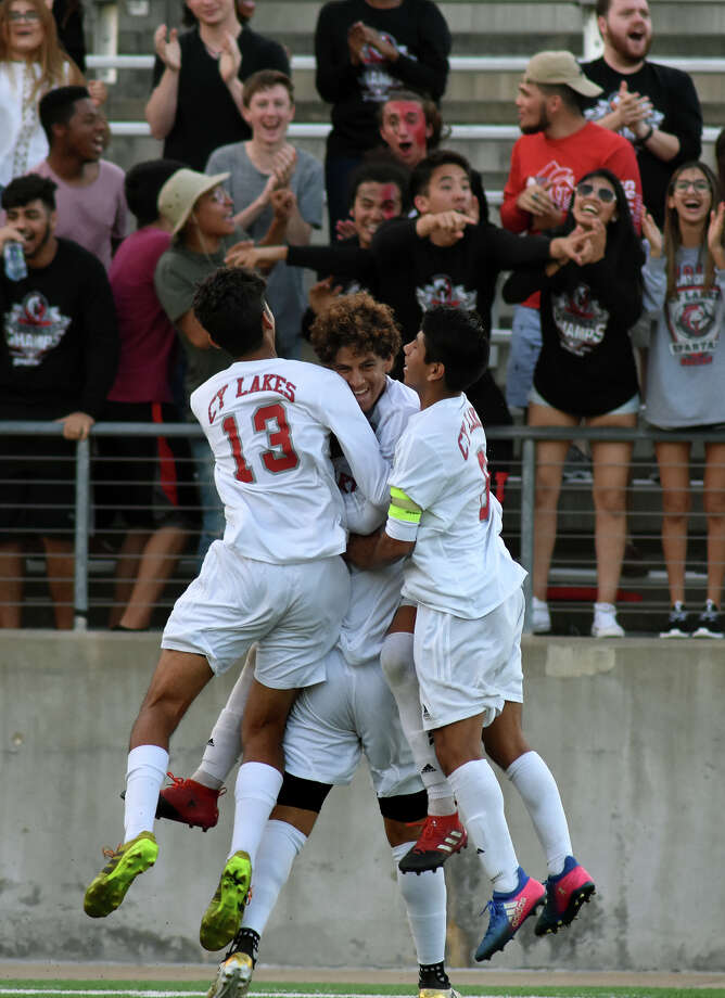 Cy Lakes senior midfielder Jordi Cobo, top center, shares a hug with Spartan junior midfielder Ricky Aguilar, center, and teammates Randy Nunez (13) and Rogelio Lopez, right, after Cobo scored his goal against Westbury in the second half of their Region III-6A Bi-District Soccer playoff matchup at Cy-Fair FCU Stadium in Cypress on March 23, 2017. (Photo by Jerry Baker/Freelance) Photo: Jerry Baker, Freelance / Freelance