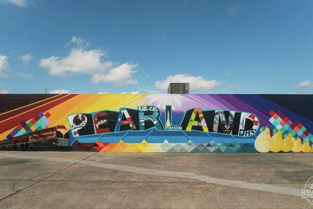 Pearland has a hot new photo spot - a mural at The Sugared Pear Boutique, 3532 E. Broadway.