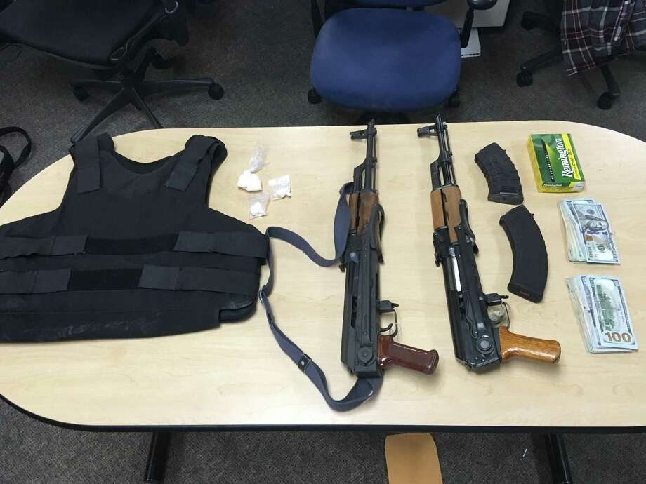 Santa Rosa police confiscated two assault rifles, ammunition, body armor, cocaine and cash from a home Wednesday, police said.