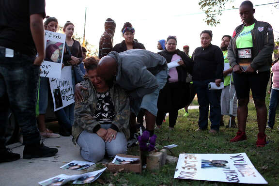 """Rosemary Garcia is comforted by her husband, Savrin Price, at a memorial for her daughter, Destiny Garcia, who was shot and killed at the location on Hays Street days earlier, during a """"shooting response"""" march held by StandUp SA on November 18, 2016."""