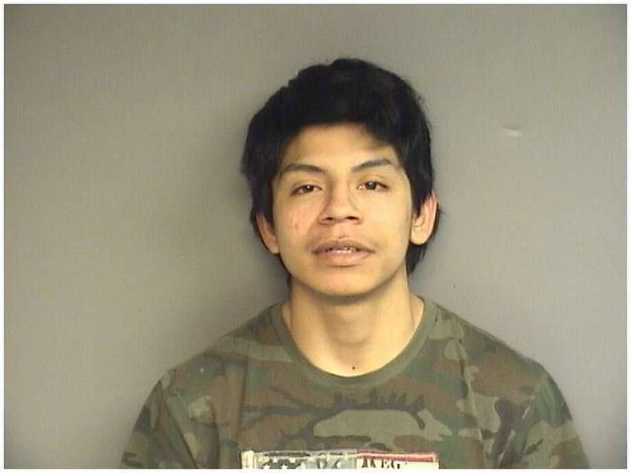 Jose Perez, 18, of Stamford, was charged with driving a stolen car the wrong way past police headquarters on Bedford Street and leading police on a pursuit into Greenwich early Friday morning. Photo: Stamford Police / Contributed