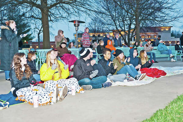 The fourth annual Edwardsville Unplugged is scheduled to take place from 7 p.m. to 10 p.m. Saturday in Edwardsville City Park. The event, hosted by the Edwardsville High School Environmental Club, takes place in honor of Earth Hour, an international environmental movement where millions of people around the globe turn off their lights to bring awareness to climate change.   Edwardsville Unplugged begins at 7 p.m where participants can enjoy live music by A440, EarthDad, Rightquick, and Stephen.     At 8:30 p.m., the official start of Earth Hour, the lights in the park will go dark and only acoustic music will be played during Earth Hour.     During the event attendees will have the opportunity to purchase food, luminarias, and glowsticks with all proceeds to support the EHS Environmental Club. Pictured is part of the crowd that attended last year's event.