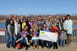 The Edwardsville/Glen Carbon Junior Service Club poses with city staff and the Watershed Nature Center Board members after receiving a $25,000 donation.