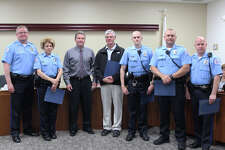 EPD officers and Edwardsville citizen Jerry Cato pose with Edwardsville Mayor Hal Patton after receiving lifesaving awards and recognition for their efforts.