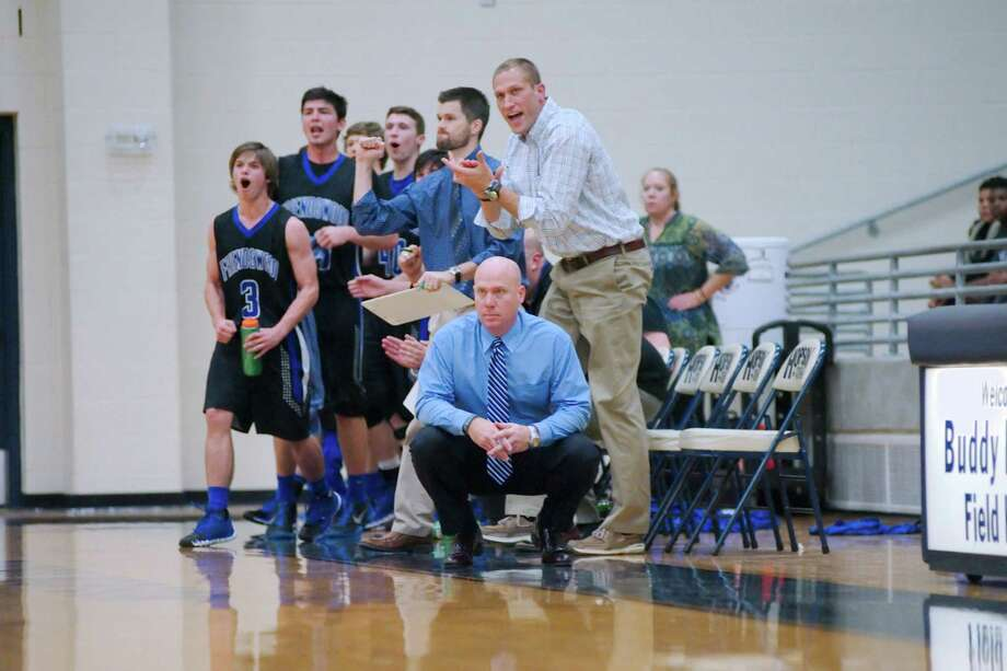 Friendswood head basketball coach Jeff Keener (kneeling) has accepted the job of district athletic coordinator in the Fort Bend Independent School District. Cliff Owens (standing at  right ) is a strong candidate to succeed Keener. Photo: Kirk Sides / © 2014 Kirk Sides / Houston Community Newspapers