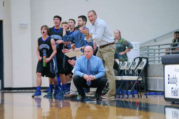 Friendswood head basketball coach Jeff Keener (kneeling) has accepted the job of district athletic coordinator in the Fort Bend Independent School District. Cliff Owens (standing at right ) is a strong candidate to succeed Keener.