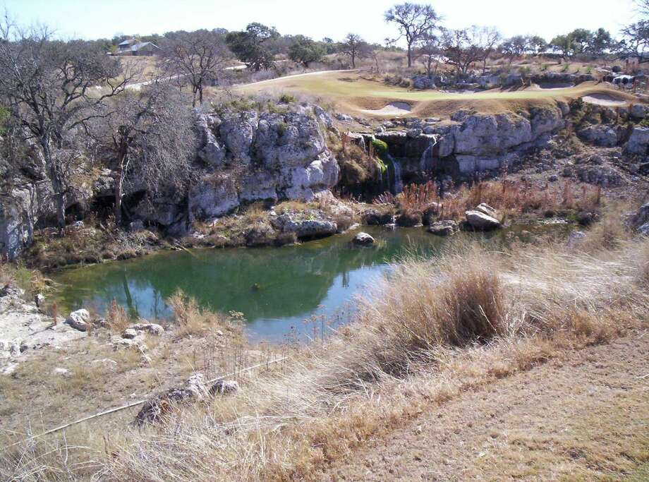 Like many golf courses in the area, Cordillera Ranch incorporates natural rock features with water on its layout, including here at the award-winning par-3 No. 16. Photo: RICHARD OLIVER, STAFF / SAN ANTONIO EXPRESS-NEWS / RCOLIVER@EXPRESS-NEWS.NET
