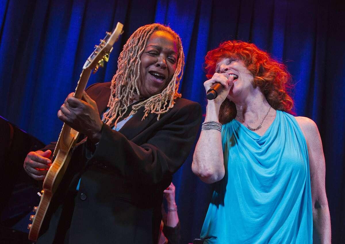 Pat Wilder and (right) Pamela Rose singing