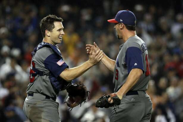 United States' Buster Posey and Luke Gregerson celebrate after the United States defeated Japan, 2-1, in a semifinal in the World Baseball Classic in Los Angeles, Tuesday, March 21, 2017. (AP Photo/Chris Carlson)