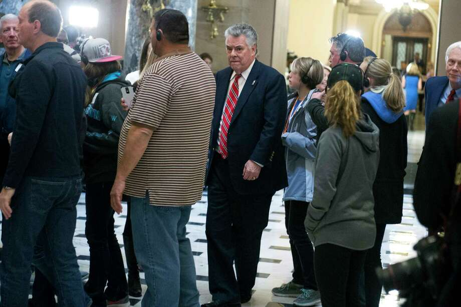 House Intelligence Committee member Rep. Peter King, R-N.Y., squeezes past tourist in Statuary Hall on Capitol Hill in Washington, Friday, March 24, 2017, after voting on a rule to consider the Republican health care overhaul. Photo: Cliff Owen, AP / FR170079 AP