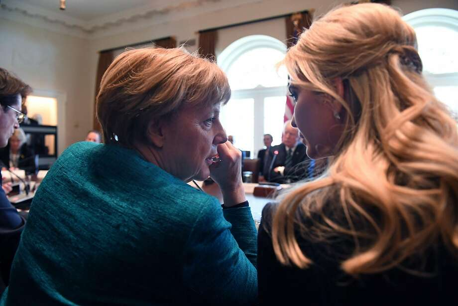 Ivanka Trump (right) confers with German Chancellor Angela Merkel last week in Washington. Photo: Pool
