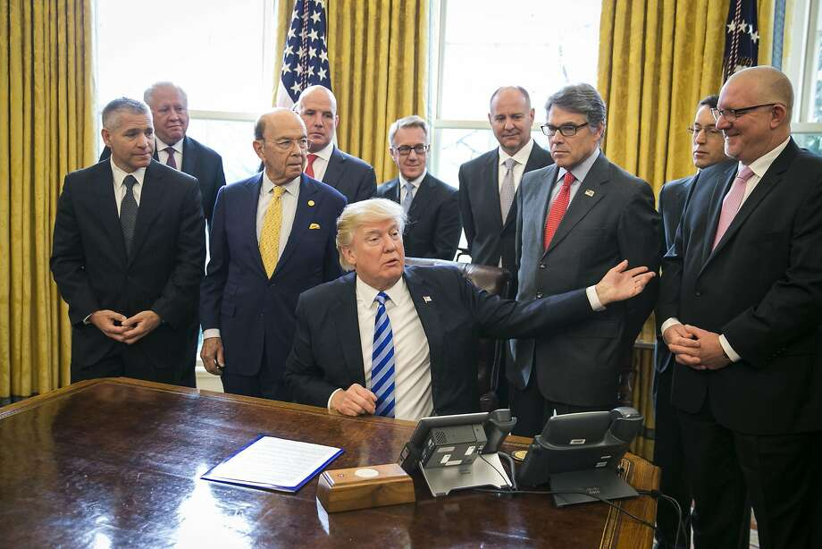 President Trump, flanked by Commerce Secretary Wilbur Ross (left) and Energy Secretary Rick Perry (right) at the White House, announces his backing for the Keystone pipeline. Photo: AL DRAGO, NYT