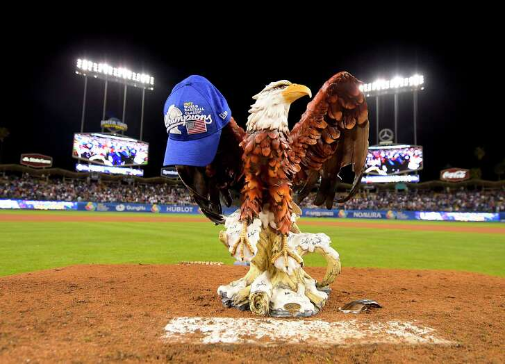 United States eagle statue mascot stands on the mound in celebration, a blue cap jauntily hanging from one of its large wings, after their 8-0 win over Puerto Rico in the final of the World Baseball Classic in Los Angeles, Wednesday, March 22, 2017. (AP Photo/Mark J. Terrill)
