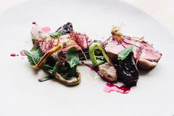 Lamb shoulder grilled over redwood, spring garlic, beets, walnut butter, mint, and seaweed photographed at Commonwealth in San Francisco, Calif. on Monday, March 20, 2017.