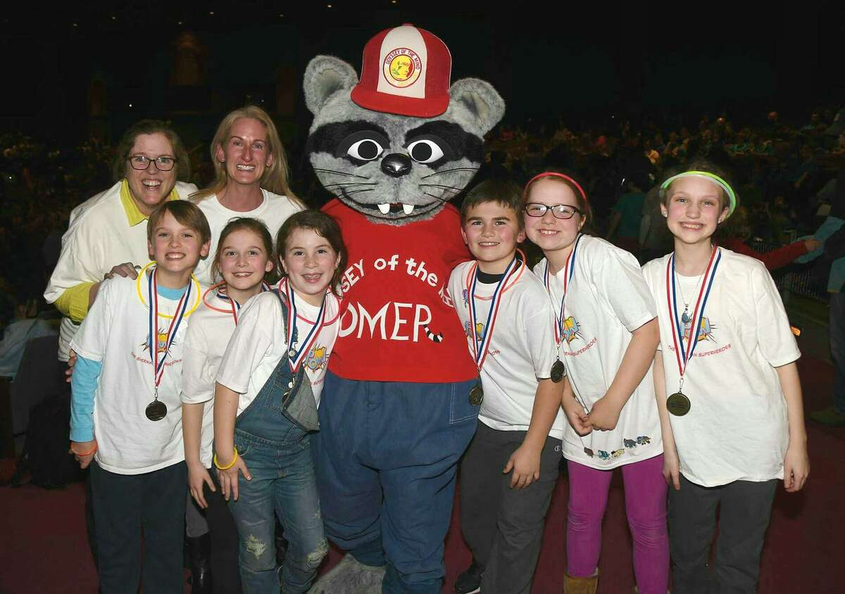 """A team from Roger Sherman Elementary School tied for first place at regionals and has qualified for ?""""Odyssey of the Mind?"""" world finals in Michigan in May. From left: Coaches Suzee Meehan and Susannah Emra and students Jack Emra, Elizabeth Dayton, Addy Dignon, Omer, Andrew Sakey, Libby Meehan and Sabine Brown."""