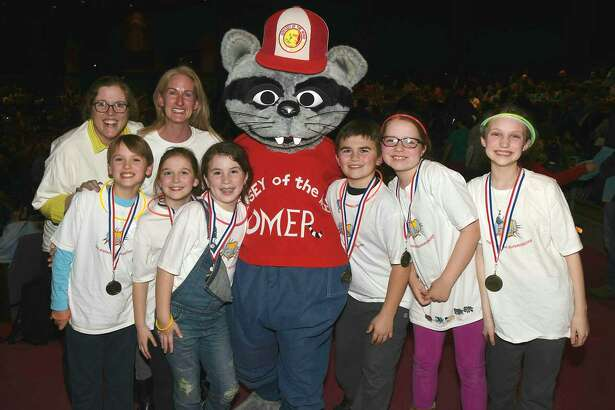 """A team from Roger Sherman Elementary School tied for first place at regionals and has qualified for """"Odyssey of the Mind"""" world finals in Michigan in May. From left: Coaches Suzee Meehan and Susannah Emra and students Jack Emra, Elizabeth Dayton, Addy Dignon, Omer, Andrew Sakey, Libby Meehan and Sabine Brown."""