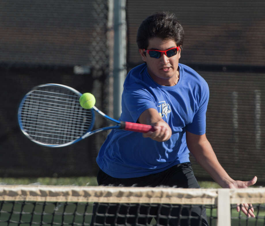 Ashwin Gurru, with Trinity School, returns a shot 03-24-17 during doubles play with Porter Hankins at the TAPPS 1-4A semifinals at Bush Tennis Center. Tim Fischer/Reporter-Telegram Photo: Tim Fischer/Midland Reporter-Telegram