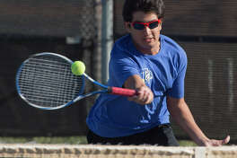 Ashwin Gurru, with Trinity School, returns a shot 03-24-17 during doubles play with Porter Hankins at the TAPPS 1-4A semifinals at Bush Tennis Center. Tim Fischer/Reporter-Telegram