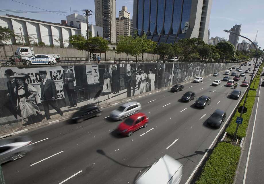Murals along Avenida 23 de Maio in Sao Paulo were once hailed by the mayor's office. In January, they were painted over, igniting a debate over protecting art. Photo: Andre Penner, Associated Press