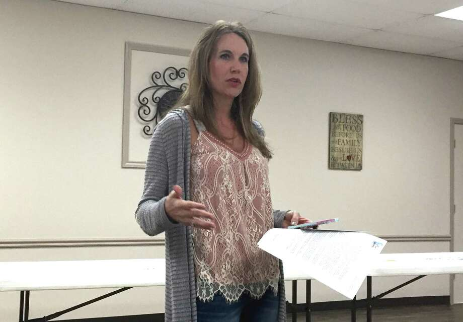 Denise Mears talks about the nonprofit group Free the Captives during the Kingwood Positive Interaction Program on Tuesday, March 21. Photo: Julie Silva