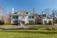 The 19-room colonial house at 54 Welles Lane sits on a 2.15-acre property near the end of a cul-de-sac and won the HOBI Award for Best Custom Home construction in the 11,000 to 12,000 square foot category in 2007.